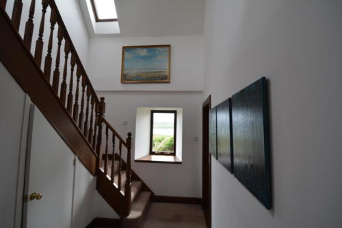 Art arranged around a feature staircase