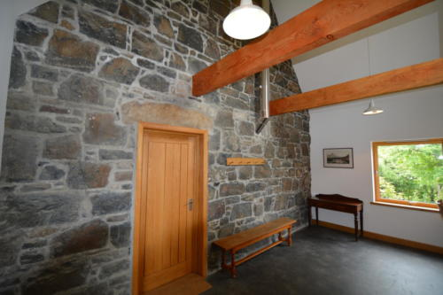 The stone walls reveal the house's origins
